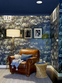 Zachary wrapped the den in moody Limerence wallpaper from House of Hackney.