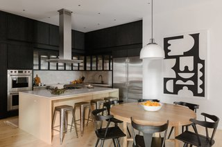 The architects reused much of the existing walnut cabinetry, giving it an ebonized finish for contrast.