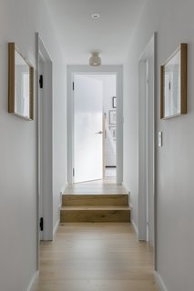 """Now, a short hallway joins the two bedrooms and shared bathroom, which is through the door to the left. """"It's large enough to feel like the loft that it is, but also intimate in these back areas,"""" says Watts."""