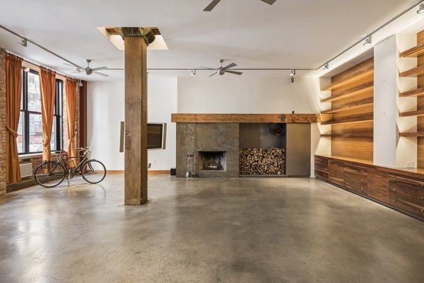 Before: The 2,700-square-foot loft had a sizable great room with enviable features, including exposed brick walls and heavy timber structural beams.