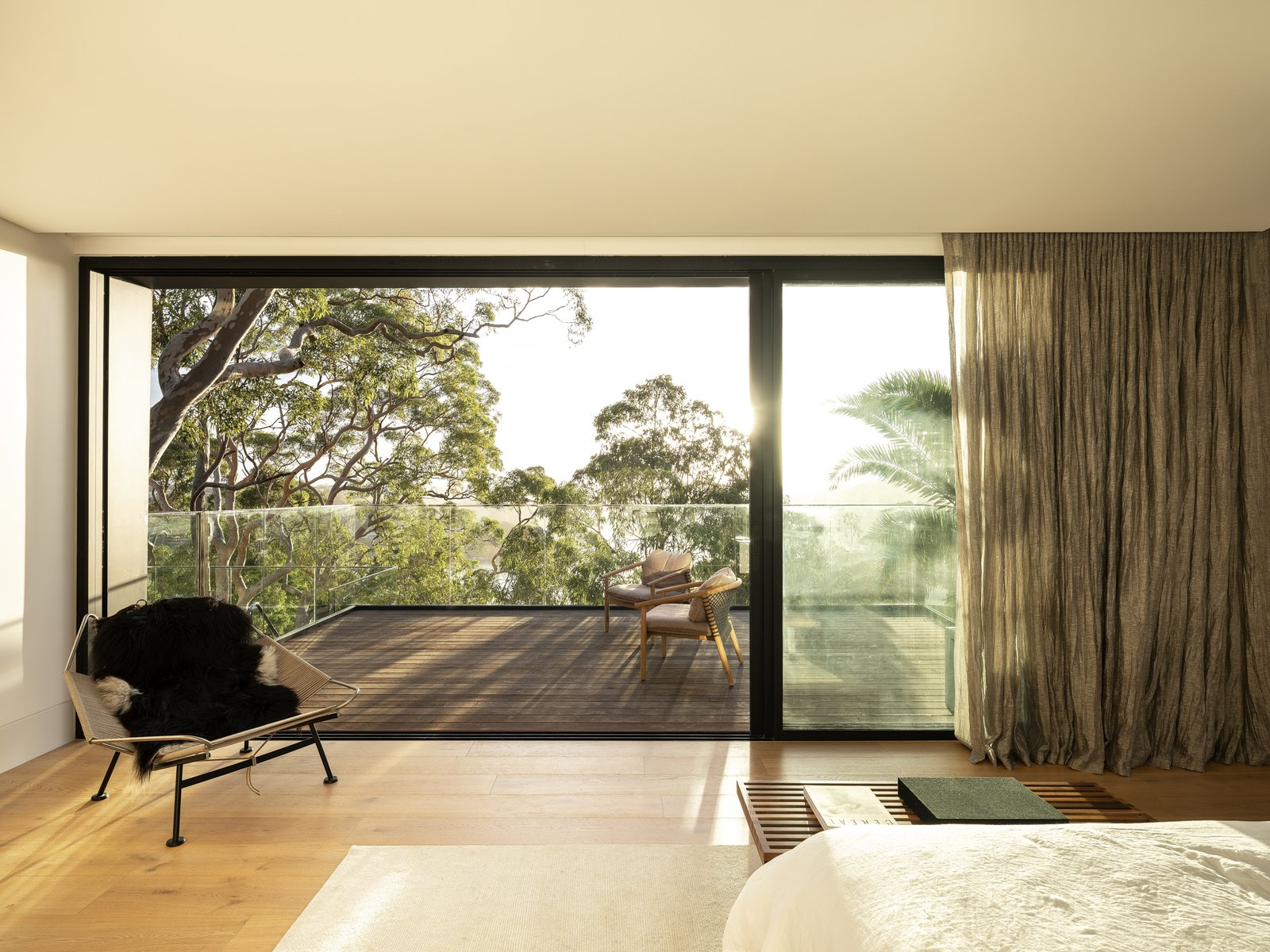 Master bedroom of Higher Ground by Stafford Architecture