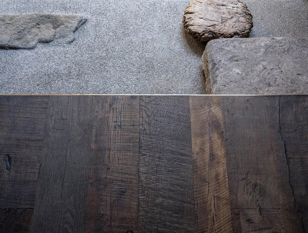 """A detail shot of the threshold between the tea room and the small courtyard. """"All the flooring materials come from my friend Guohua's brand 'sense things,'"""" says Liu. """"Guohua has been a close friend of Bob and me for many years, and we have been doing our best to help each other throughout the whole process."""""""