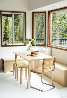 Gibson built a window bench out of birch plywood and that was paired with an Ikea table and a vintage Cesca chair by Marcel Breuer in the dining nook.