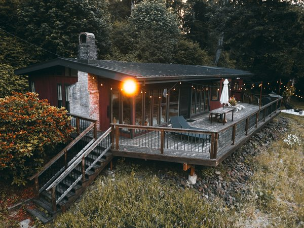A generously-sized, comfortable deck lines the water side of the cabin.