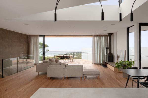 "The rear wall with stacking sliding doors opens to surrounding decks and the ""hero"" view."