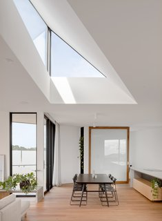 A dramatic, triangular skylight brings in a play of natural light throughout the day.