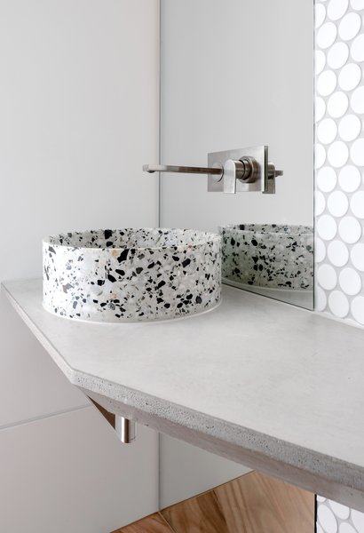 In a powder room, a terrazzo basin makes a statement.