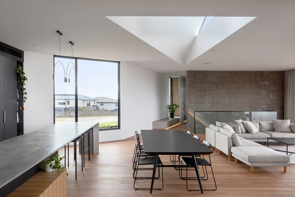 An open floor plan hosts the kitchen, dining, and living room. Strategic angled walls and window positions control the views of the neighborhood, as well as the greater vistas.