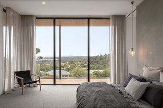 The main bedroom is wrapped by the deck on two sides to enjoy the view.
