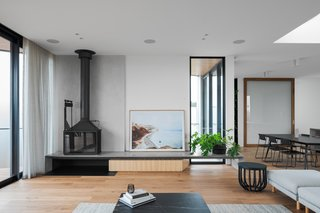 The concrete hearth at the fireplace has angled sidewalls and a bevelled edge.