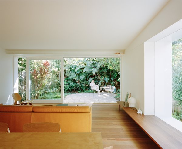 Sliding glass doors spanning 15 feet create a generous exchange between the main interior and rear yard.