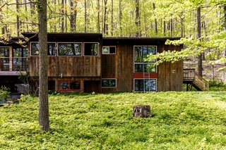 The 1956 home sits on a tree-filled lot in Connecticut, and was originally designed and built by local architect Cyril K. Smith, who studied under Louis Kahn.