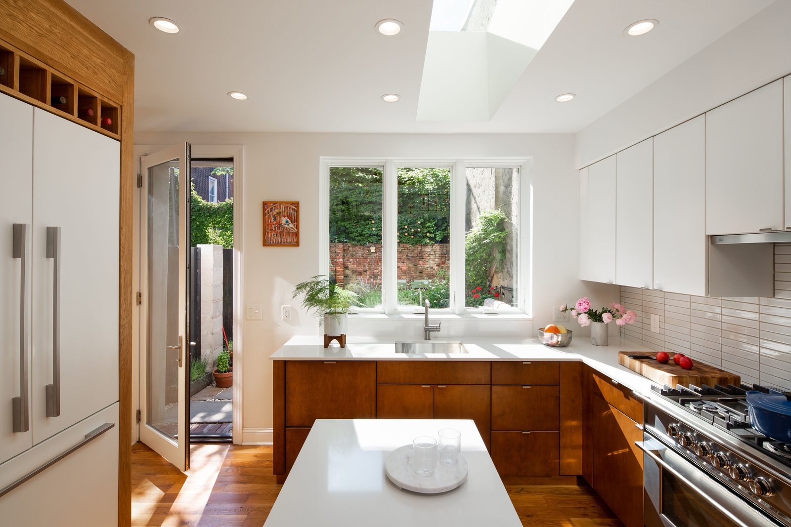 Creating a connection between the kitchen and backyard makes the room