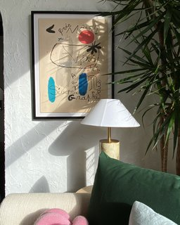 "A framed Joan Miro piece makes for an eye-catching corner. ""I really love vintage art,"" says Natalie, who scours eBay for her collection. ""You can find some really special pieces."""