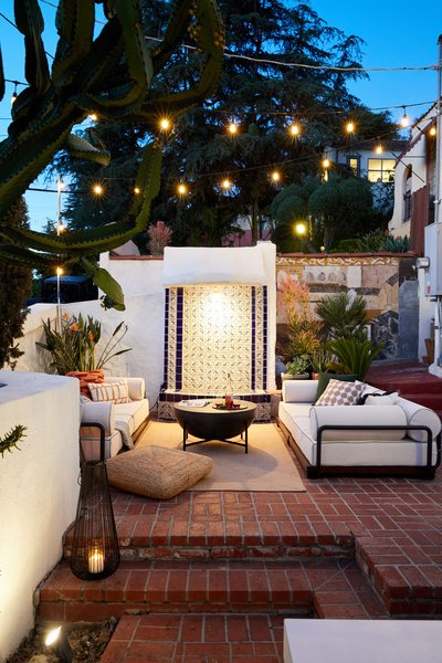 The outdoor living room can accommodate anything from movie night to a morning work session.