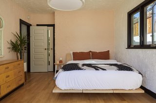 Accent walls in the bedroom are painted in Backdrop's 'Harajuku Morning' and the bed is the Floyd Platform Bed.