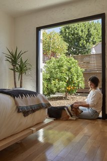 A citrus tree sits right outside double doors in the bedroom.