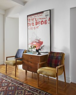 The furniture, rugs, and art are from the owners' collection.