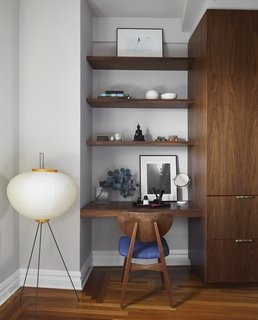 This built-in area can be used as a desk or vanity.