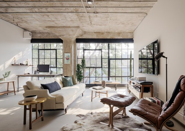 The firm preserved many key features of the 1,100-square-foot loft, including the beautifully textured ceiling.