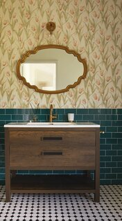 A playful mix of tile and floral wallpaper embellishes the bathroom.