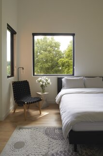 "In an upstairs bedroom, windows capture intentional views of the trees and farm activity. ""Someone living in New York City, they have the thirst of wanting to connect with nature—and what better way to connect with nature other than going to a farm and experiencing farming?"" says Eugene."