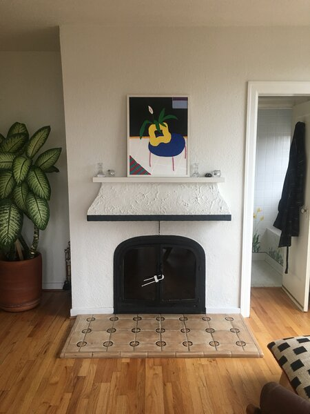 Before: The fireplace had a lackluster treatment and scarce mantel space.