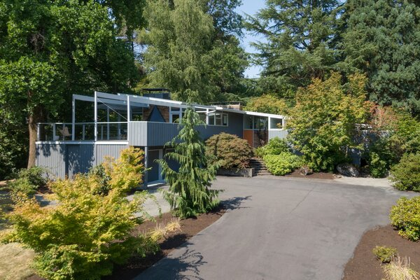 The home sits on a generous .7-acre lot in the northwest Portland neighborhood of Cedar Mill, just north of the Nike campus. The site boasts many mature trees, and it once hosted a fruit orchard.