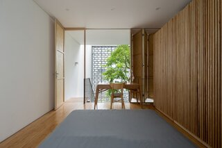 The fifth-floor kid's bedroom is made to feel more cozy with wood flooring and folding wooden screens, the latter of which facilitate privacy or connection to the main spaces.