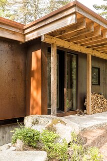 "The materials were kept simple: a foundation of board-formed concrete that reveals the wood grain of the boards used to make it, Cor-Ten steel siding that will develop a characterful patina, and rafters made of hemlock, a local species. ""In terms of materials, we wanted the full exterior of the building to be something that would weather gracefully, that required very little maintenance, and that had a long life cycle,"" says Shaw."