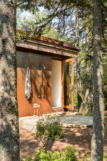 The outdoor shower is in constant use and was a request from the clients. It's accessed through the indoor shower.