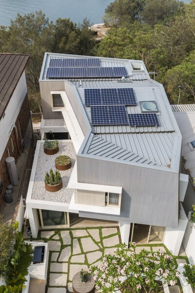 A photovoltaic roof array supplies 92% of the home's electricity usage, with future plans to increase those capabilities with battery storage. There are also systems for rainwater harvesting and greywater recycling.