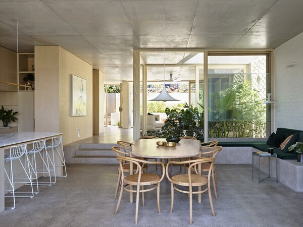 The view from the kitchen-dining room shows the glassed-in, central garden lightwell, accessible via large sliders.