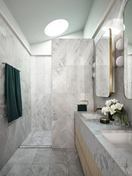 In the main bathroom, Artedomus Elba stone, a honed marble, covers the walls and floor.
