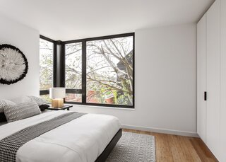 The lower level has a moveable wardrobe wall that divides the main bedroom from the second room.