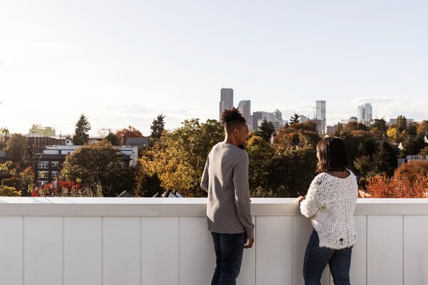 """Claudine and Isaiah enjoy the view from the rooftop deck. """"A place that provided a sense of serenity was huge for us, especially living in the city and with our busy lifestyle,"""" say the couple. """"We wanted a place we can come home to and feel relaxed and at peace."""""""