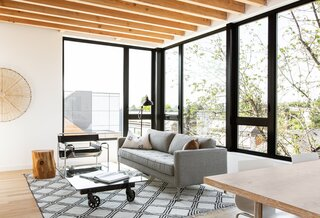 "Hybrid stuck to a simple palette for the home's finishes. ""We chose to expose the roof framing to really add some warmth to the space,"" says Humble."