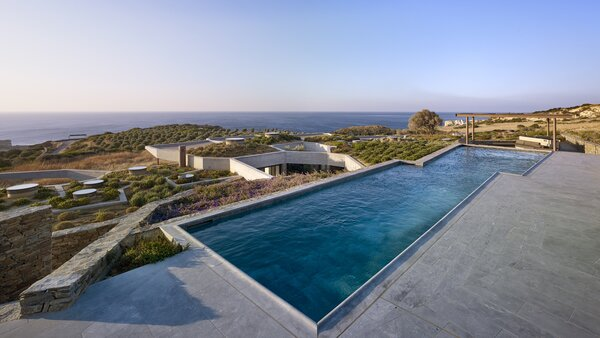 "The choice of materials for their tactile qualities extended to the pool. ""The same marble that's outside is inside of the swimming pool,"" says Loperena. ""So, you look into it, and you immediately feel cool looking at it. And you go in and you feel it."""