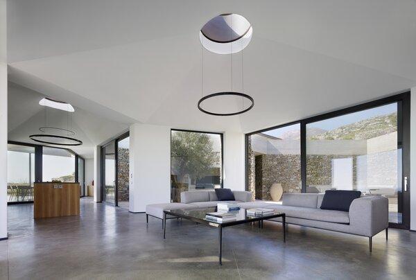 Custom pendant lights hang below the skylights in the roof.