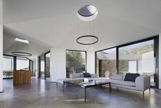 Custom pendant lights hang below the skylights in the roof.