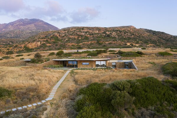 """In a sense, we treated earth as one of our materials,"" says Vaitsos. ""We figured out how much earth we needed to excavate in order to position this house here. And then we used it to transform the landscape a little bit."" This was done to create as little waste as possible."