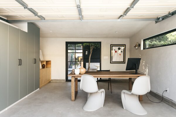 The garage interior was completely redone with a new concrete floor, glass doors, and practical storage.