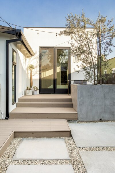 A small deck and a custom concrete planter complete the seating area off of the main bedroom.