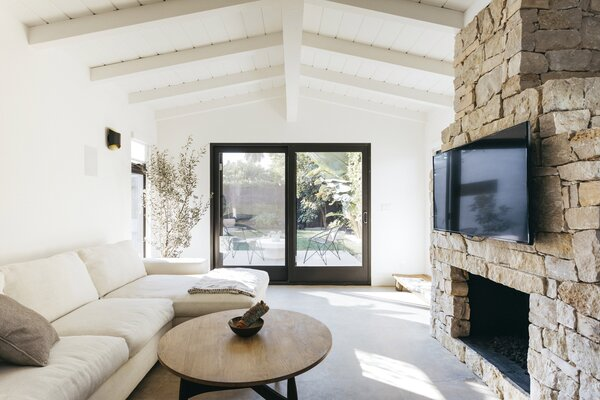 A new sliding glass door leads to the backyard, enhancing the flow from interior and exterior.