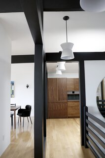The flooring throughout the main floor is a light-toned rustic oak by Woodpecker Flooring.