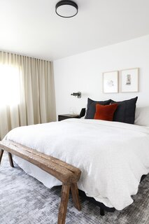 The bedroom is a soothing retreat with soft textures.