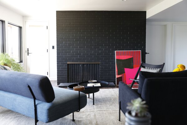 The Ruby Sofa from West Elm joins the Slope Arm Chair, also from West Elm. The artwork is by Brian Sanchez, a Seattle artist. All of the artwork was curated by Lauren Gallow.