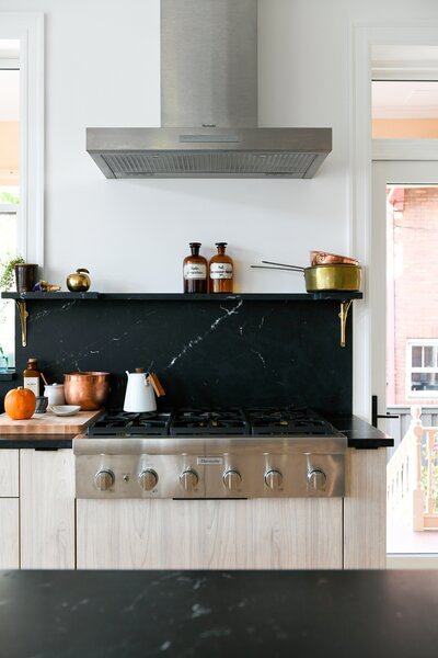 The couple chose Thermador appliances from Don's Appliances. The black Nero Marquina marble counters are in a high honed finish, which kept them from becoming too gray in the finish process.