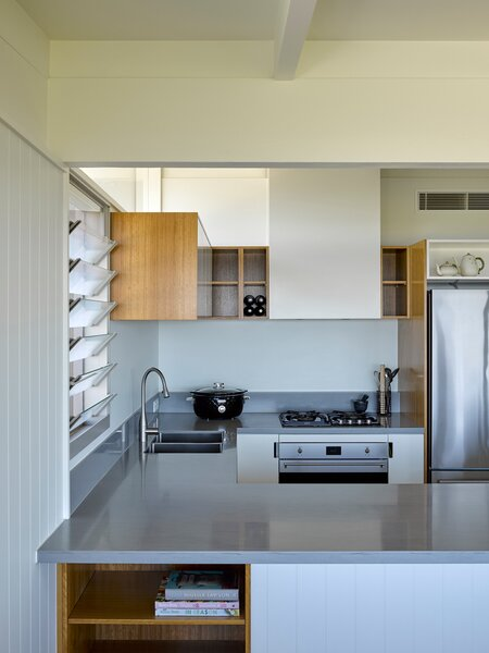 The modest U-shaped kitchen has an open peninsula on one side.