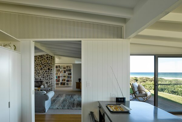 The kitchen enjoys great sight lines through the house and to the ocean.